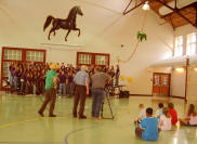 The Stallion Singers perform a song about the Long Legacy.