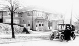 R. A. Long's Pierce Arrow limousine in front of garage, before 1914