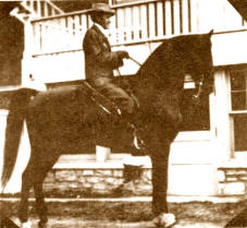 Mr. R. A. Long on his great saddle gelding, Redbuck.