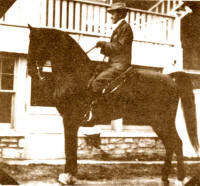 Mr. R. A. Long on his great saddle gelding, Redbuck
