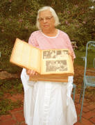 Virginia with her grandmother's scrapbooks